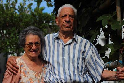 Francisco Soares da Silva (Ribeiras, Pico), born 1924, and his wife, Cidalia Maria Silveira da Silva (Calheta de Nesquim, Pico), married in 1949 and pictured among their grapevines outside their house in Horta, Faial. August 7, 2012.