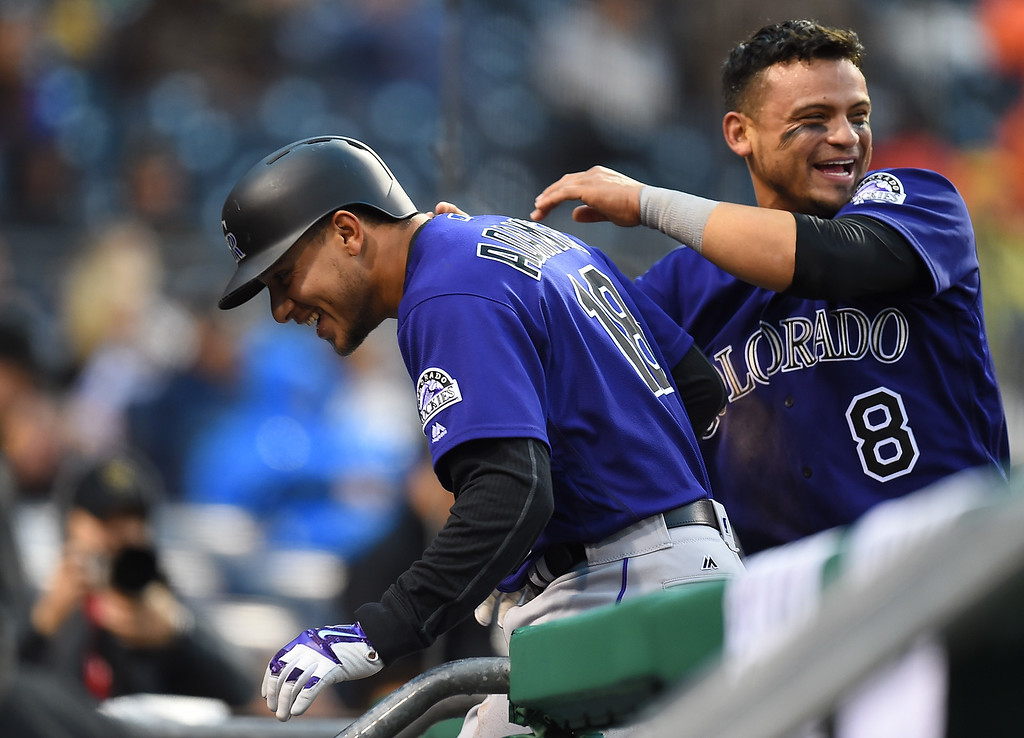 . PITTSBURGH, PA - MAY 21:  Cristhian Adames #18 of the Colorado Rockies celebrates his two run home run with Gerardo Parra #8 during the ninth inning against the Pittsburgh Pirates on May 21, 2016 at PNC Park in Pittsburgh, Pennsylvania.  (Photo by Joe Sargent/Getty Images)