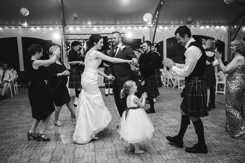 People dance as the pipers perform.