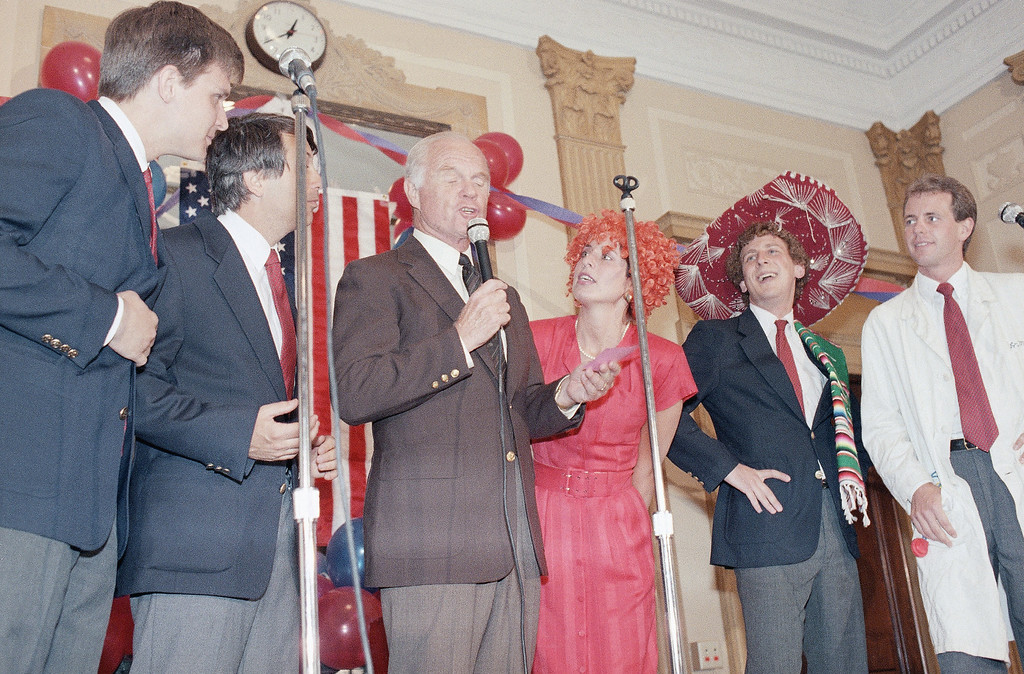 ". Sen. John Glenn, D-Ohio, sings along with a musical group called the ""Capitol Steps\""  during a surprise birthday party in his honor, on Capitol Hill on Thursday, July 17, 1986 in Washington.   Glenn will be 65-years-old on Friday. (AP Photo/Lana Harris)"