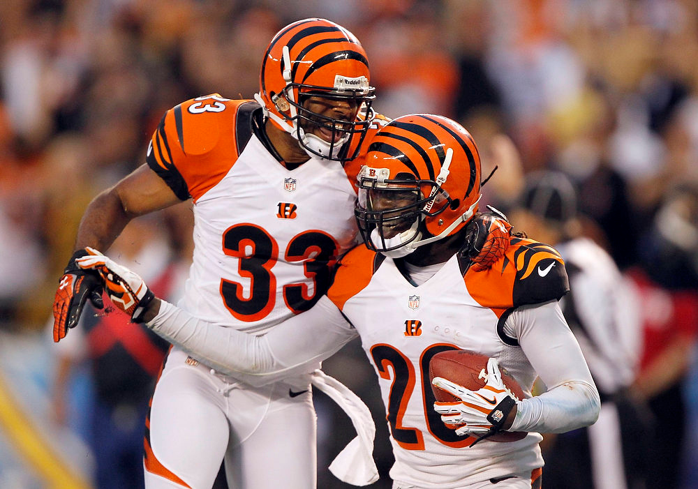 Description of . Cincinnati Bengals free safety Chris Crocker (33) celebrates with free safety Reggie Nelson (R) upon Nelson's interception of a pass from San Diego Chargers quarterback Philip Rivers (not pictured), in the fourth quarter of their NFL football game in San Diego, California December 2, 2012. The Bengals won the game 20-13. REUTERS/Alex Gallardo