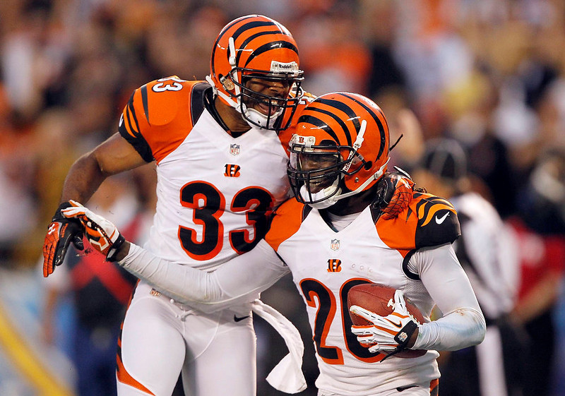 . Cincinnati Bengals free safety Chris Crocker (33) celebrates with free safety Reggie Nelson (R) upon Nelson\'s interception of a pass from San Diego Chargers quarterback Philip Rivers (not pictured), in the fourth quarter of their NFL football game in San Diego, California December 2, 2012. The Bengals won the game 20-13. REUTERS/Alex Gallardo