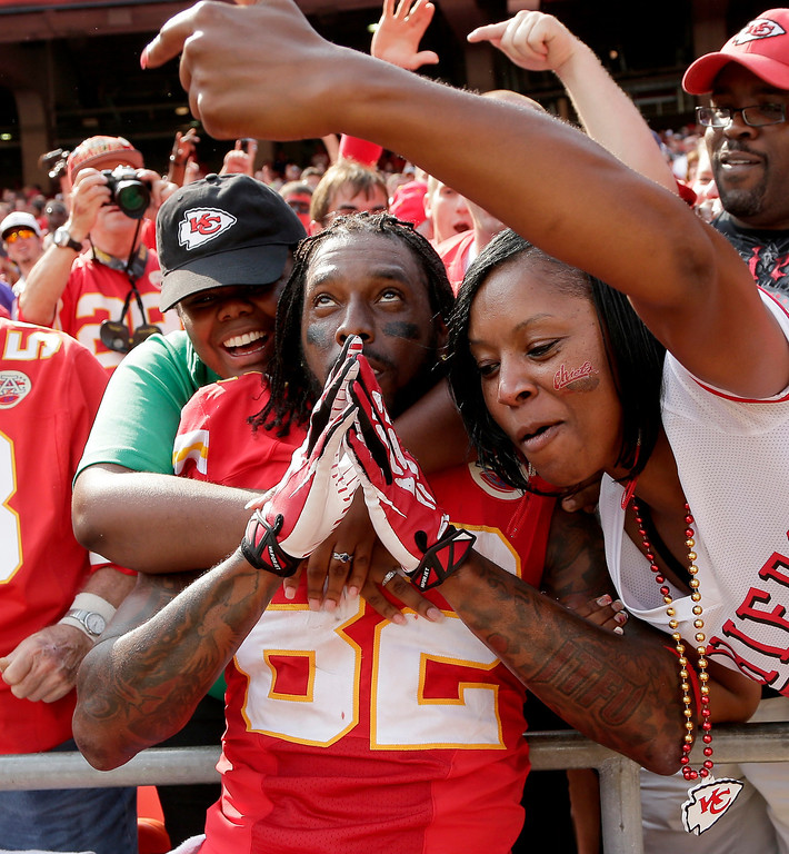 . Kansas City Chiefs wide receiver Dwayne Bowe (82) celebrates with fans after 17-16 win over the Dallas Cowboys in an NFL football game  Sunday, Sept. 15, 2013, in Kansas City, Mo.  (AP Photo/Charlie Riedel)