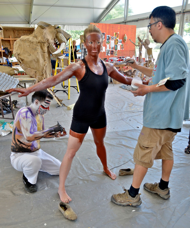 . Jeff Forman/JForman@News-Herald.com Artists Jose Luis Calvo, left, and Rapho  Valdivieso paint Lisa Walsh for her role in a piece in the Cleveland Museum of Art 25th annual Parade the Circle June 14 in University Circle.