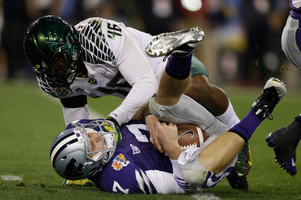 Description of . Michael Clay #46 of the Oregon Ducks sacks Collin Klein #7 of the Kansas State Wildcats in the second quarter of the Tostitos Fiesta Bowl at University of Phoenix Stadium on January 3, 2013 in Glendale, Arizona.  (Photo by Ezra Shaw/Getty Images)