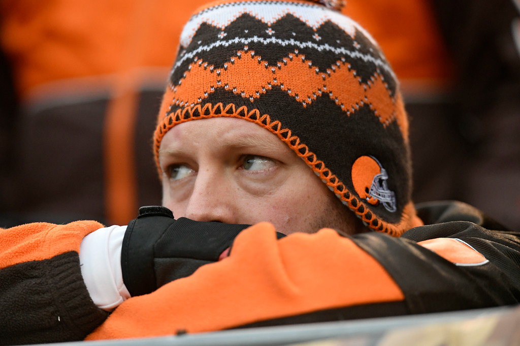 . A Cleveland Browns fan watches during the second half of an NFL football game between the Baltimore Ravens and the Cleveland Browns, Sunday, Dec. 17, 2017, in Cleveland. (AP Photo/David Richard)