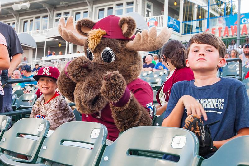 Frisco RoughRiders mascot Bull Moose entertains fans between innings of an MiLB game against the Corpus Christi Hooks at Dr. Pepper Ballpark in Frisco, Texas, Sunday, June 26, 2016. (Photo by Sam Hodde)
