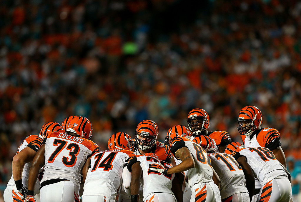 . MIAMI GARDENS, FL - OCTOBER 31:  The Cincinnati Bengals call a play during a game against the Miami Dolphins at Sun Life Stadium on October 31, 2013 in Miami Gardens, Florida.  (Photo by Mike Ehrmann/Getty Images)