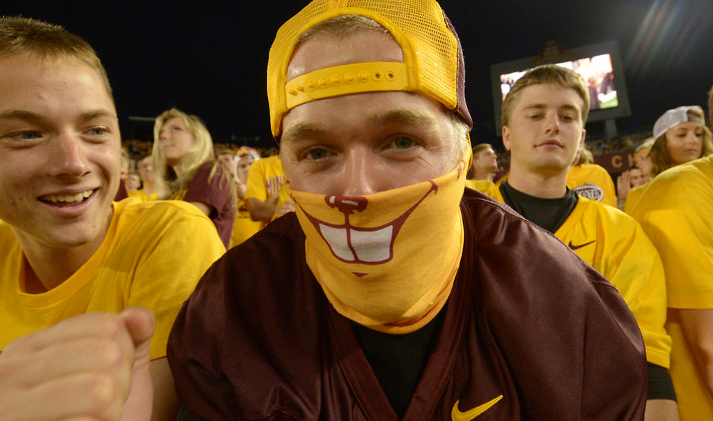 . University of Minnesota senior Clint Newmann wears a gophers scarf as he cheers on the Gophers in the third quarter. (Pioneer Press: John Autey)
