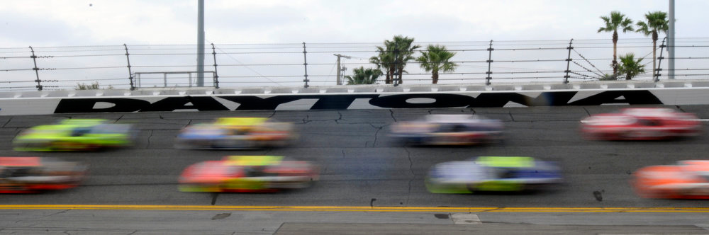 . Cars drive through turn four during the NASCAR Daytona 500 auto race at Daytona International Speedway in Daytona Beach, Fla., Sunday, Feb. 15, 2009. (AP Photo/Paul Kizzle)