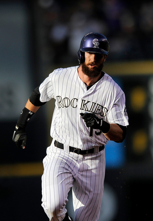 . Colorado Rockies Charlie Blackmon rounds the bases after hitting a solo home run in the first inning of a baseball game against the Arizona Diamondbacks on Thursday, June 5, 2014, in Denver. (AP Photo/Chris Schneider)