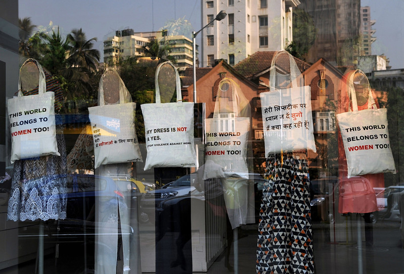 . White cloth bags emblazoned with slogans denouncing rape are seen hung from mannequins at a fashion store in Mumbai on March 8, 2013. International Women\'s Day is marked on March 8 every year. PUNIT PARANJPE/AFP/Getty Images