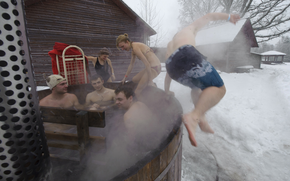 . People take part in the European Sauna Marathon in Otepaeae, southern Estonia, on February 10, 2013. Around 600 participants in 150 teams compete in the event to find out which team takes the shortest time to use 22 saunas and to jump into nine ice holes.     AFP PHOTO / RAIGO PAJULA / ESTONIA OUTRAIGO PAJULA/AFP/Getty Images