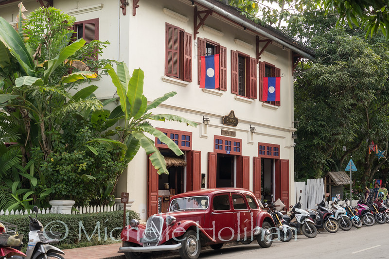 LUANG PRABANG, LAOS - JANUARY 7, 2019: Unidentified tourists walk by colonial era builings.