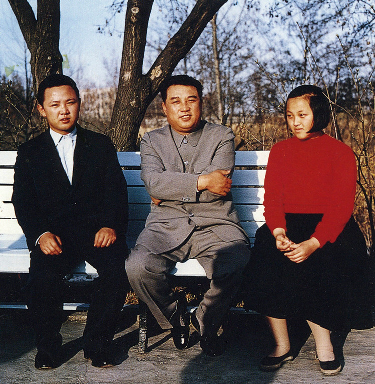 . In this 1963 photo from North Korea\'s official Korean Central News Agency, distributed by Korea News Service, Kim Jong Il (left) takes part of a souvenir picture with leader Kim Il Sung and his sister, Kim Kyong Hui at the yard. (Korean Central News Agency/Korea News Service via AP Images)
