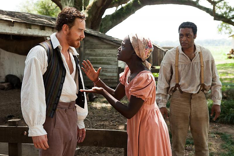 ". Left to right: Michael Fassbender, Lupita Nyong\'o and Chiwitel Ejifor on the plantation in ""12 Years a Slave.\"" Provided by Fox Searchlight"
