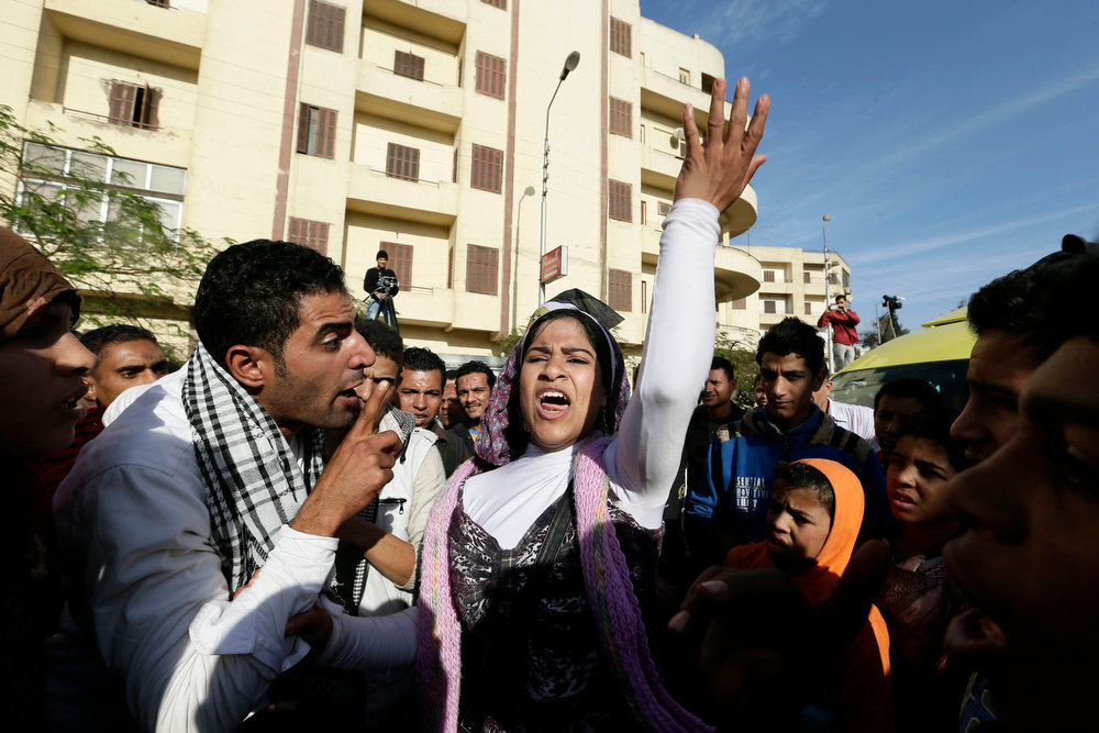 . Egyptian protesters chant anti Muslim Brotherhood slogans outside the presidential palace in Cairo, Egypt, Thursday, Dec. 6, 2012. The Egyptian army deployed tanks and gave both supporters and opponents of Mohammed Morsi a deadline to leave the area outside the presidential palace Thursday following fierce street battles that left several people dead and hundreds injured in the worst outbreak of violence between the two sides since the Islamist leaderís election.(AP Photo/Hassan Ammar)