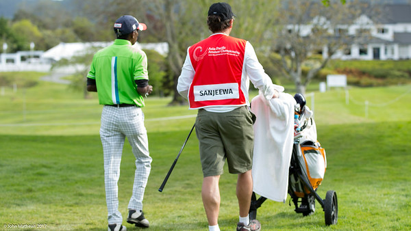B J Sanjeewa with his caddy after hitting a ball into the 18th green on  the 1st day of competition in the Asia-Pacific Amateur Championship tournament 2017 held at Royal Wellington Golf Club, in Heretaunga, Upper Hutt, New Zealand from 26 - 29 October 2017. Copyright John Mathews 2017.   www.megasportmedia.co.nz