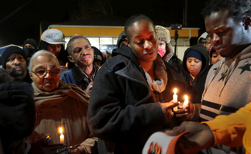 . Toni Martin-Green, front center, and her husband Jerome Green, right, participate in a candlelight vigil at a Berkeley, Mo., gas station on Wednesday, Dec. 24, 2014. The mayor of the St. Louis suburb of Berkeley urged calm Wednesday after a white police officer killed black 18-year-old Antonio Martin who police said pointed a gun at him, reigniting tensions that have lingered since the death of Michael Brown in neighboring Ferguson. (AP Photo/St. Louis Post-Dispatch, Robert Cohen)