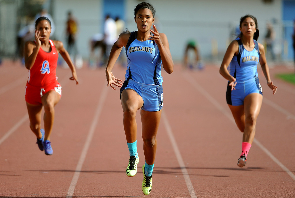. Walnut\'s Kayla Richardson wins the 100 meter dash during the Hacienda League track finals in Walnut, Calif., on Thursday, May 8, 2014.  (Keith Birmingham Pasadena Star-News)