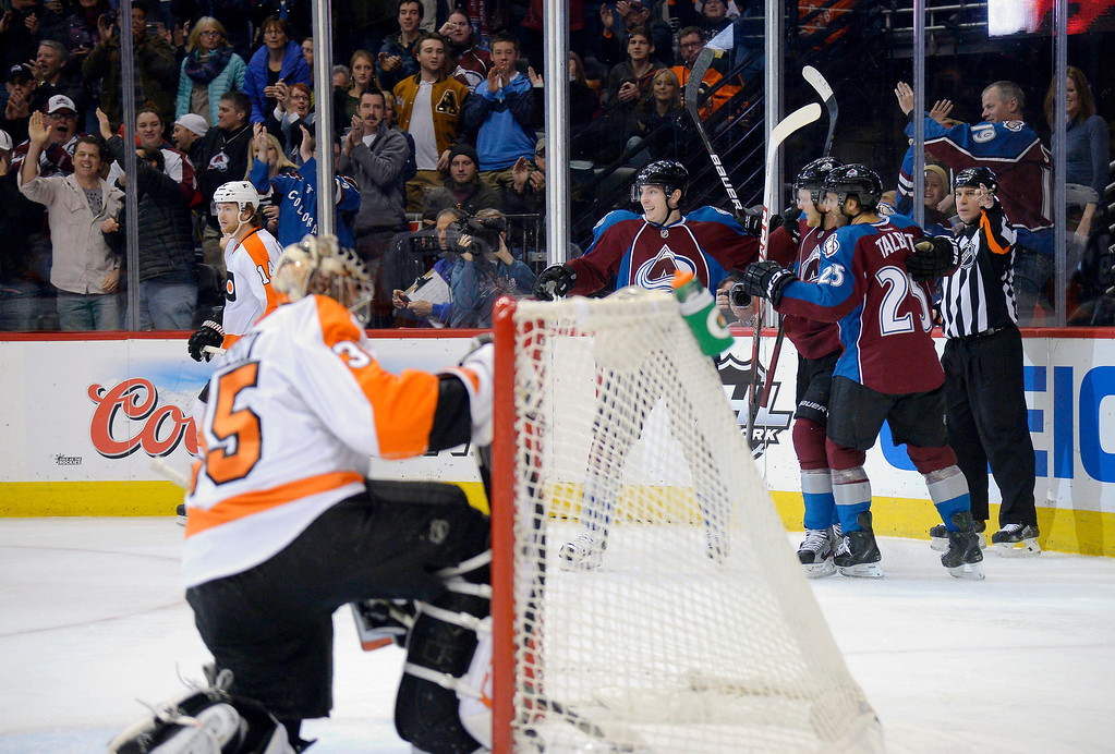 . Colorado Avalanche center Matt Duchene (9) and Colorado Avalanche center Maxime Talbot (25) celebrate a goal during the first period on January 2, 2014 at Pepsi Center. (Photo by John Leyba/The Denver Post)
