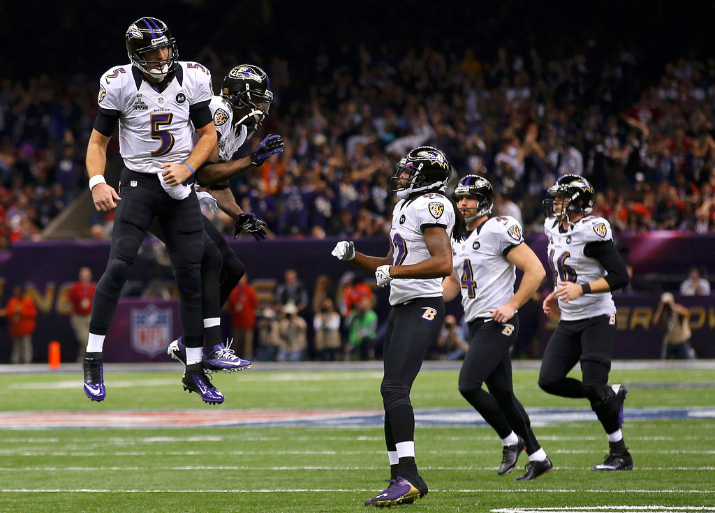 . Baltimore Ravens quarterback Joe Flacco (5) celebrates with his teammates after his second touchdown pass of the game against the San Francisco 49ers during the second quarter of the NFL Super Bowl XLVII football game in New Orleans, Louisiana, February 3, 2013. REUTERS/Brian Snyder
