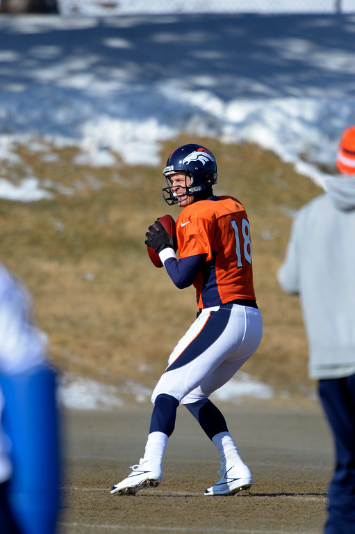 . Denver Broncos quarterback Peyton Manning (18) drops back to pass during practice January 23, 2014 at Dove Valley.   (Photo by John Leyba/The Denver Post)