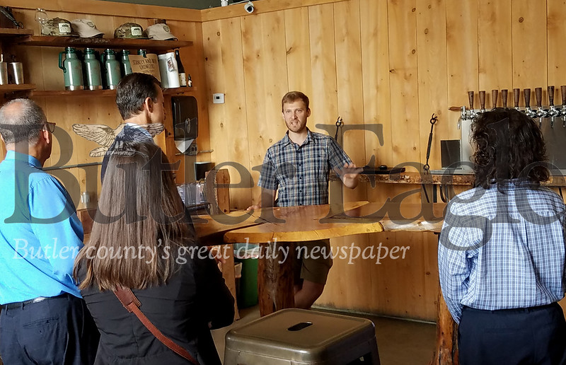 """Mars Walk 2: Photo by Samantha Beal. """"Nick Salkeld (second from right) of Stick City Brewing Company told government officials touring the borough yesterday Mars is a 'great town' for his business."""""""