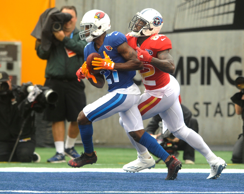. NFC cornerback Patrick Peterson (21), of the Arizona Cardinals, intercepts a pass in the end zone as, AFC tight end Delanie Walker (82), of the Tennessee Titans, defends, during the first half of the NFL Pro Bowl football game, Sunday, Jan. 28, 2018, in Orlando, Fla. (AP Photo/Steve Nesius)