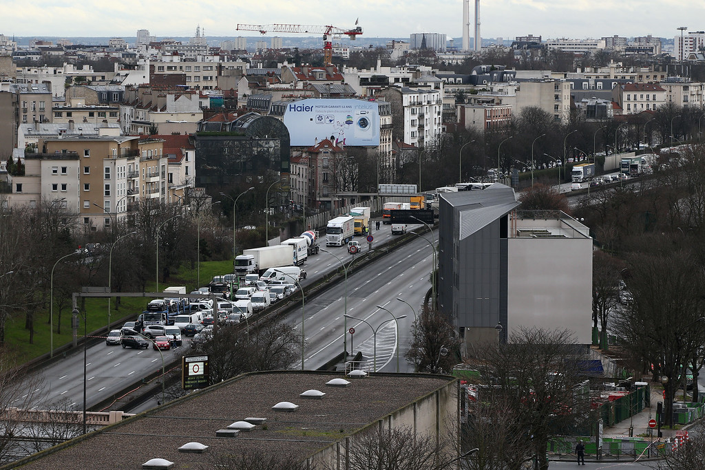 . Traffic backs up due to road closures as police mobilize with reports of a hostage situation at Port de Vincennes on January 9, 2015 in Paris, France. According to reports at least five people have been taken hostage in a kosher deli in the Port de Vincennes area of Paris. A huge manhunt for the two suspected gunmen in Wednesday\'s deadly attack on Charlie Hebdo magazine has entered its third day.  (Photo by Dan Kitwood/Getty Images)