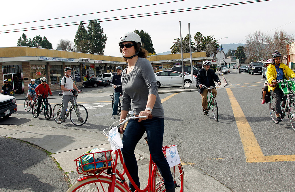 . Janet LeFleur crosses Latham Street along Escuela Ave. during the Great Streets Rengstorff Park Neighbor Bike Tour in Mountain View, Calif. on Sat., March 2, 2013.  Nearby businesses have been trying to get a stop light placed at the busy intersection, but the city only placed 4-way stop signs there recently.  (LiPo Ching/Staff)