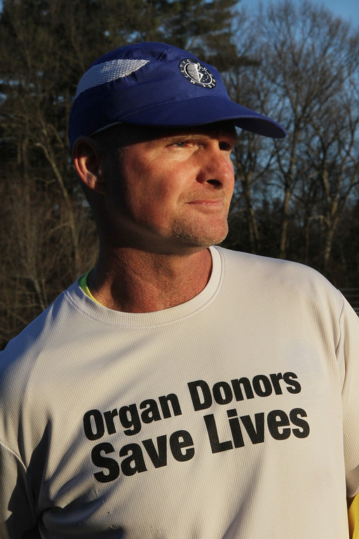 . Donald Davis, 54, of Reading, will run the Boston Marathon route Sunday a week early to raise money for DonateLife and promote organ and tissue donation. He\'s originally from Billerica. (SUN/Julia Malakie)
