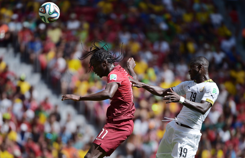 . Portugal\'s forward Eder (L) and Ghana\'s defender Jonathan Mensah  vie during the Group G football match between Portugal and Ghana at the Mane Garrincha National Stadium in Brasilia during the 2014 FIFA World Cup on June 26, 2014.  (GABRIEL BOUYS/AFP/Getty Images)