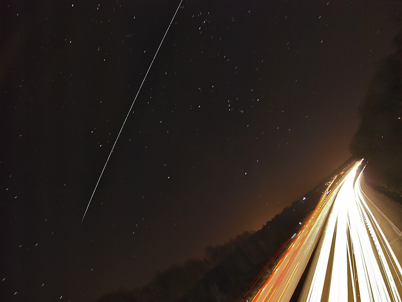 Feb 19 2012. The International Space Station (ISS) 1845hrs pass over UK skies. The super bright ISS travelling at 17,500mph flies over the more sedate 70mph motorway traffic at Lutterworth, Leics. A different off-level composition. To capture this photo I was perched on top of a motorway bridge and placed camera on tripod shooting a succession of 10s exposures. The final composite contains approx 25 images and stacked using StarStax software. Captured with Olympus E3, 7-14mm, F4, 10s, ISO 250.