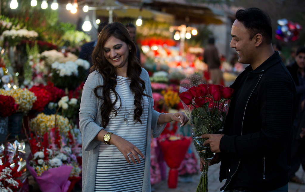 . A couple buy flowers to celebrate Valentine\'s Day, in Islamabad, Pakistan, Monday, Feb. 13, 2017. A Pakistani judge has banned Valentine\'s Day celebrations in the country\'s capital, saying they are against Islamic teachings. A court official says the judge ruled on a petition seeking to ban public celebrations. Islamist and rightwing parties in Pakistan view Valentine\'s Day as vulgar Western import. (AP Photo/B.K. Bangash)