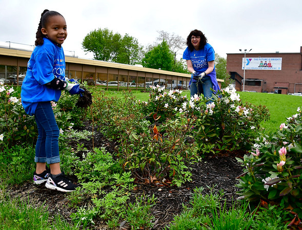 5/4/2019 Mike Orazzi   Staff Milliah Godbolt,5, works with volunteer Laurie Harris while cleaning up the New Britain Berlin YMCA as part of the 18th annual Comcast Cares Day on High Street in New Britain Saturday.