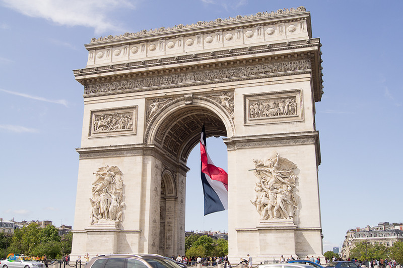 Arc de Triumph with the French flag...one of the top sights for Mexican passport holder travel to to Europe