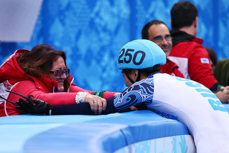 . Victor An (R) of Russia celebrates winning the gold medal with his coach in the Short Track Men\'s 500m Final A on day fourteen of the 2014 Sochi Winter Olympics at Iceberg Skating Palace on February 21, 2014 in Sochi, Russia.  (Photo by Ryan Pierse/Getty Images)