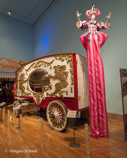 Circus wagon and stilt walker at the Ringling Museum
