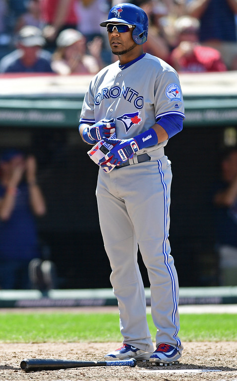 . Toronto Blue Jays\' Edwin Encarnacion removes his batting gloves after striking out in the seventh inning of a baseball game against the Cleveland Indians, Sunday, Aug. 21, 2016, in Cleveland. The Indians won 3-2. (AP Photo/David Dermer)