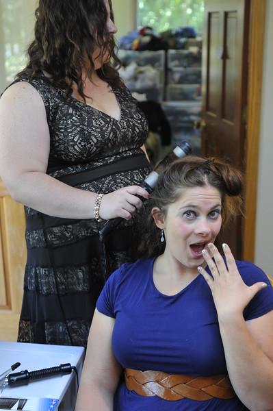 Marika helps Sam with her hair