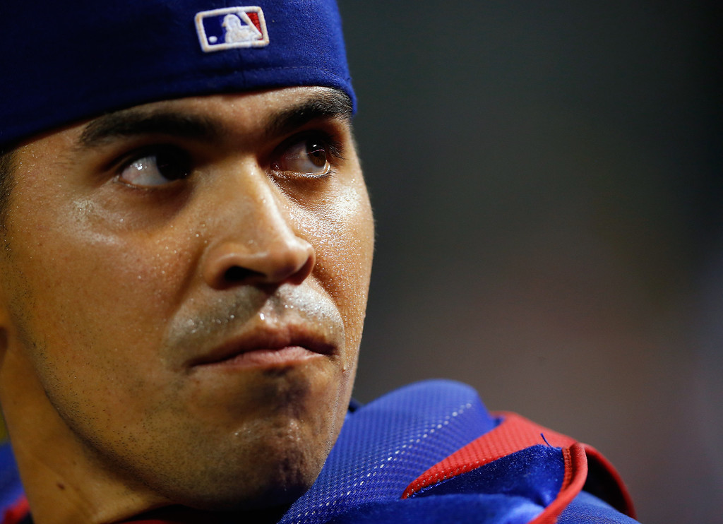 . ARLINGTON, TX - MAY 08:  Robinson Chirinos #61 of the Texas Rangers waits for the umpires to review a play at the plate in the top of the seventh inning against the Colorado Rockies at Globe Life Park in Arlington on May 8, 2014 in Arlington, Texas.  (Photo by Tom Pennington/Getty Images)