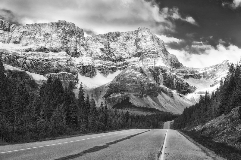 I recently returned from a trip to Banff National Park. Since it was offseason I seemingly had the place to myself (minus a lot of tourist busses). This picture was taken off the road when it was clear.  The scenes there were very dramatic. I highly recommend that you visit if you like to take landscape photos.