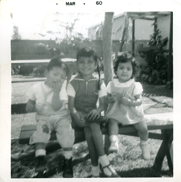 1960-03-joe-mich-n-girl-on-backyard-bench.png