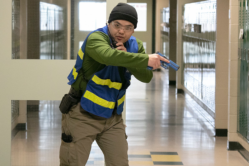 Police and firefighers from many Massachusetts departments participated in the the AAIR, Active Attack Integrated Response, class put on by ALERRT, Advanced Law Enforcement Rapid Response Training, at Sky View Middle School on Tuesday, Feb. 18, 2020. After checking a hallway Leomisnter Sgt Vang Lee radioed in during one of the scenarios. SENTINEL & ENTERPRISE/JOHN LOVE