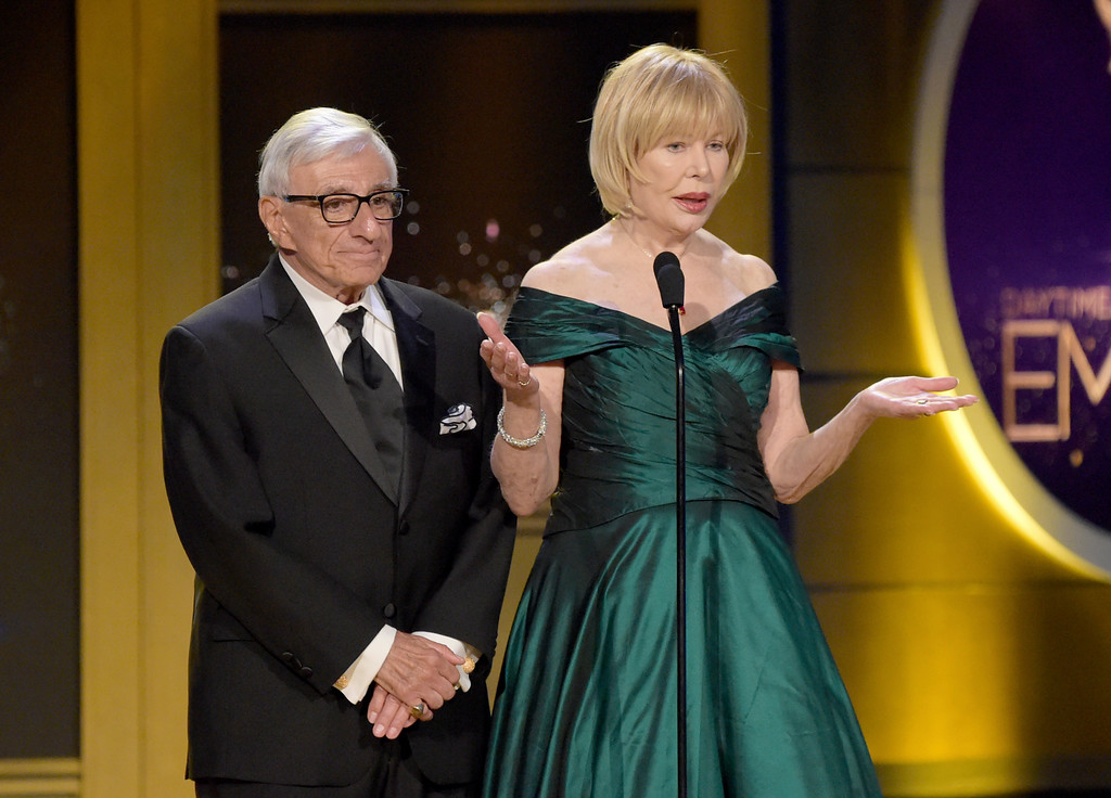 ". Jamie Farr, left, and Loretta Swit present a tribute to ""Mr. Rogers\"" at the 45th annual Daytime Emmy Awards at the Pasadena Civic Center on Sunday, April 29, 2018, in Pasadena, Calif. (Photo by Richard Shotwell/Invision/AP)"