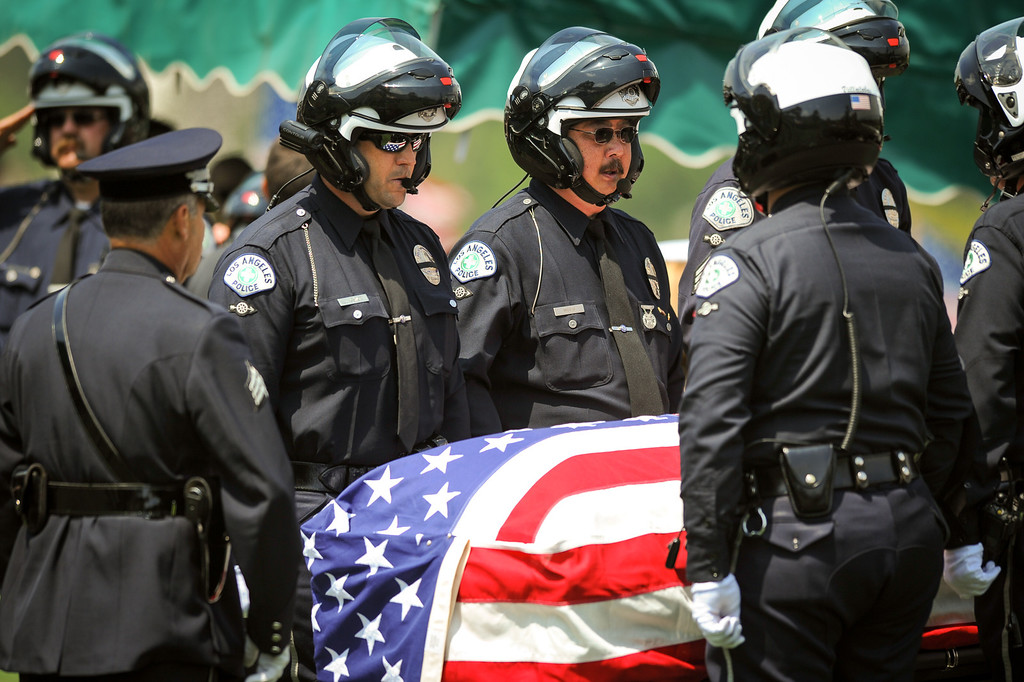 . Honorary pallbearers stand by the casket of LAPD officer Chris Cortijo, Tuesday, April 22, 2014, at Forest Lawn Hollywood Hills. (Photo by Michael Owen Baker/L.A. Daily News)