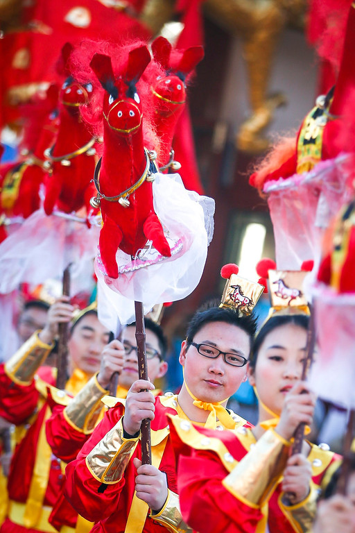 . Performers do the horse dance on the eve of the Lunar New Year, or Spring Festival, at a park fair in Beijing, China, 30 January, 2014. The Year of the Horse, according to the symbol of the 12 year cycle of animals, will begin on 31 January  EPA/DIEGO AZUBEL