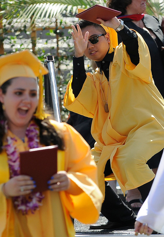 . Joshua Hermoso Sta. Maria celebrates after getting his diploma. The Commencement Exercises for the Bishop Alemany High School Class of 2013 was held at College of the Canyons in Santa Clarita, CA 6/1/2013(John McCoy/LA Daily News)