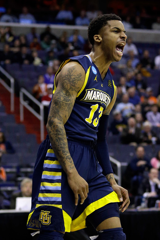 . WASHINGTON, DC - MARCH 28:  Vander Blue #13 of the Marquette Golden Eagles reacts after a dunk against the Miami (Fl) Hurricanes during the East Regional Round of the 2013 NCAA Men\'s Basketball Tournament at Verizon Center on March 28, 2013 in Washington, DC.  (Photo by Rob Carr/Getty Images)